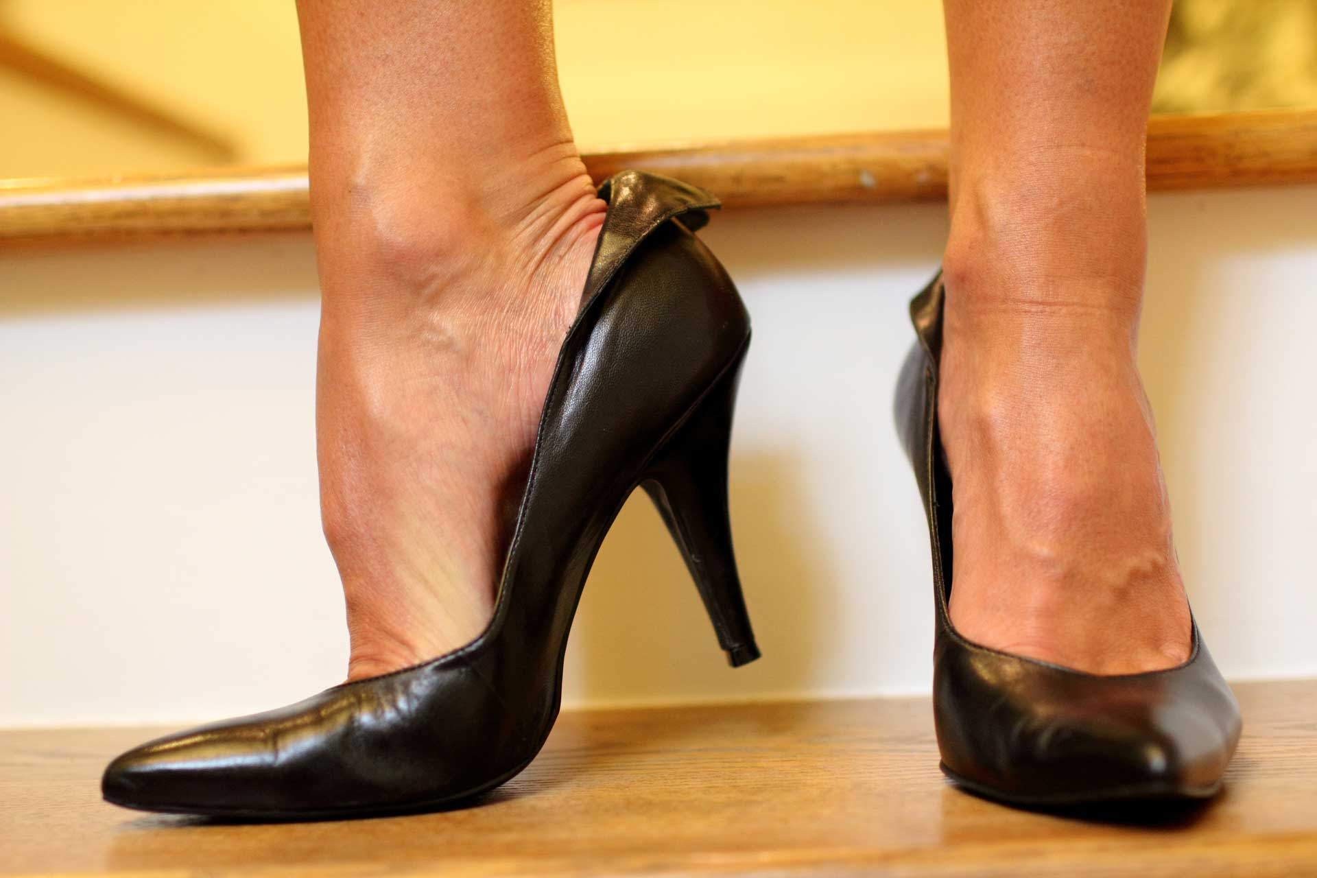 image of woman in high heels without orthotics