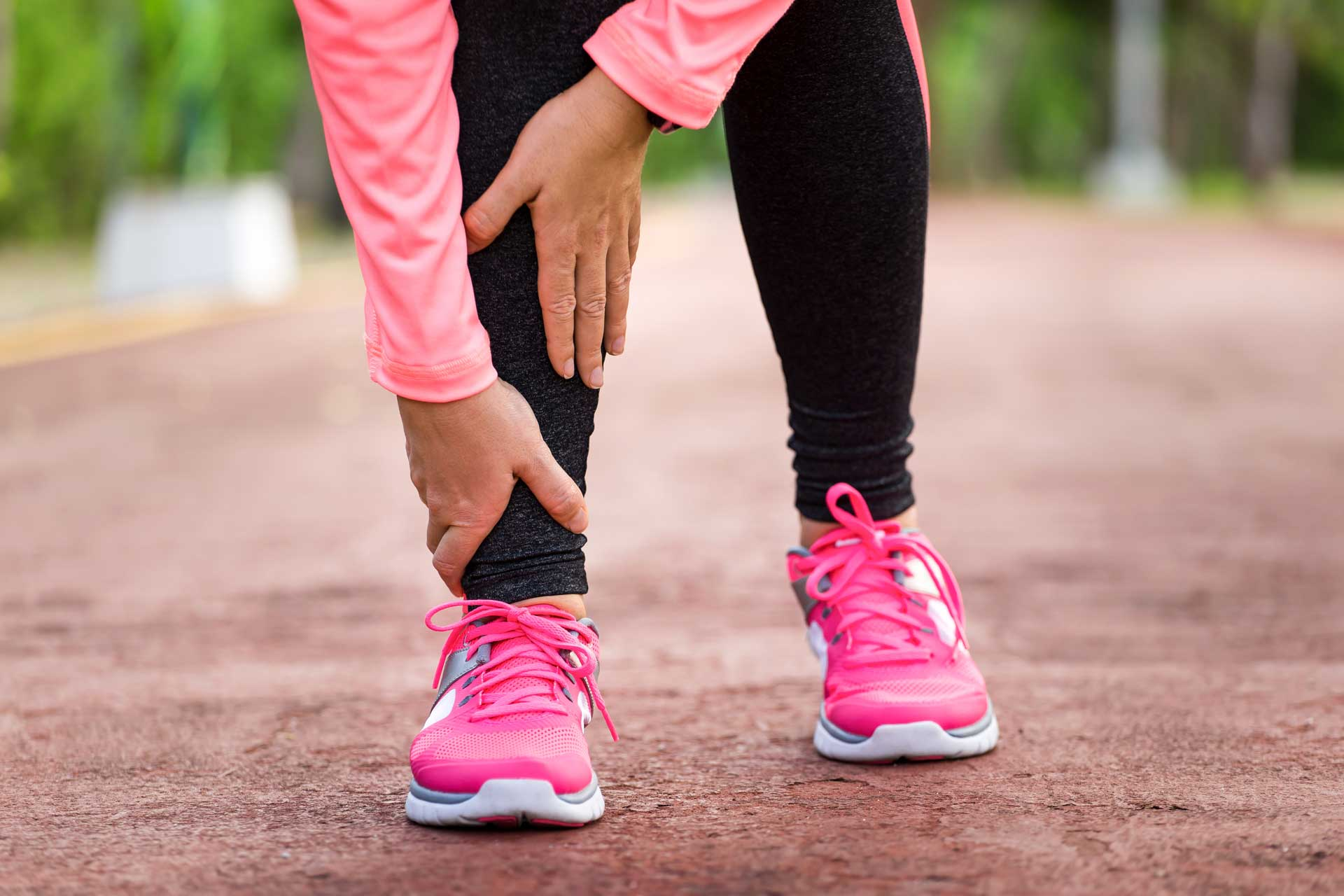Image of runner feeling pain from arthritis in the ankle - Loudoun Foot Care - Shuman Podiatry