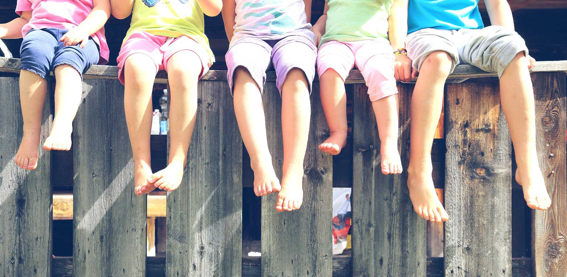 Image of kids feet on fence - Children's Foot Doctor in Sterling VA