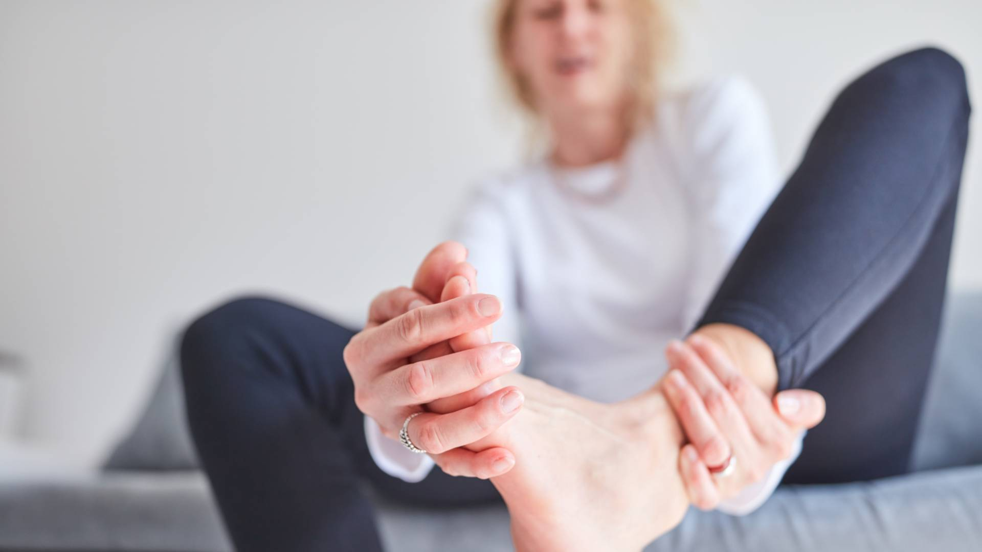 Image of woman with toe sprain pain