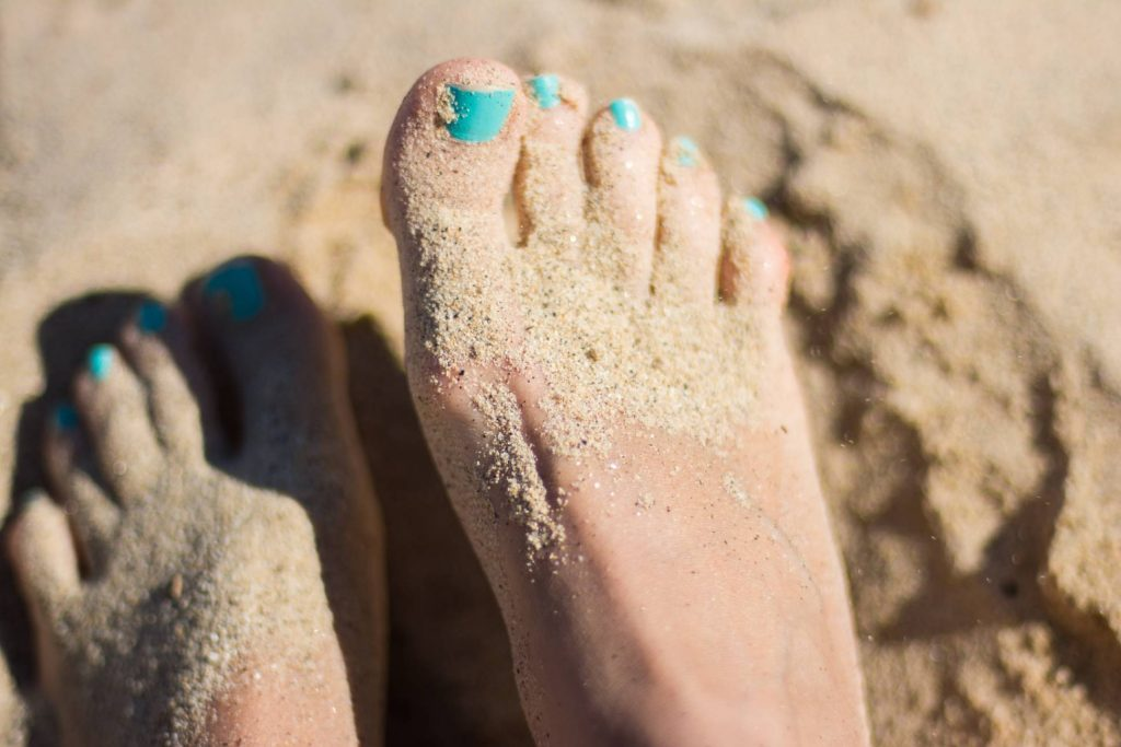 image of feet in sand - foot care and diabetes