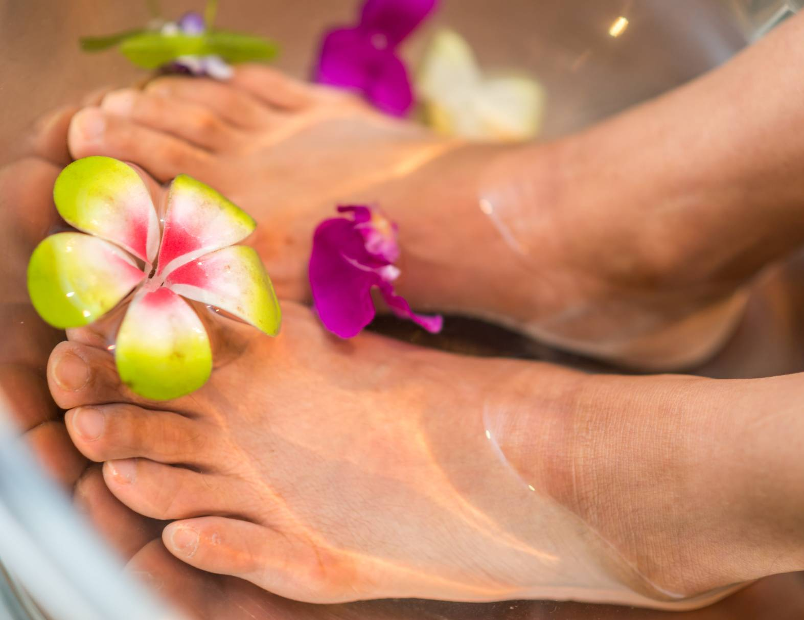 image of feet soaking with flowers